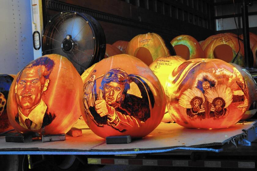 """The Jack-O-Lantern Spectacular event at the Roger Williams Park Zoo adopts a theme each year, this one being """"American Treasures,"""" featuring commemorative stamp art, heroes, endangered species and cultural icons."""