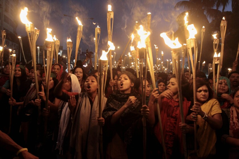 Bangladeshi activists at a torch rally in Dhaka on Thursday night, celebrating the Supreme Court's refusal to consider an appeal of the death sentence handed to opposition political leader Abdul Quader Mollah for alleged war crimes in the 1971 independence battle.