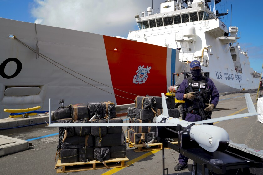 A guard stood watch of the unloading of 7,500 pounds of cocaine and marijuana in San Diego
