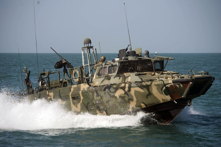"""In this Oct. 26 2015, photo provided by the U.S. Navy, Riverine Command Boat (RCB) 802, assigned to Combined Task Group (CTG) 56.7, conducts patrol operations in the Persian Gulf. Weak leadership, poor judgment, a lack of """"warfighting toughness"""" and a litany of errors led to the embarrassing capture and detention by Iran of 10 U.S. sailors in the Persian Gulf in January, according to a Navy investigation released Thursday, June 30, 2016. (Torrey W. Lee/U.S. Navy via AP)"""