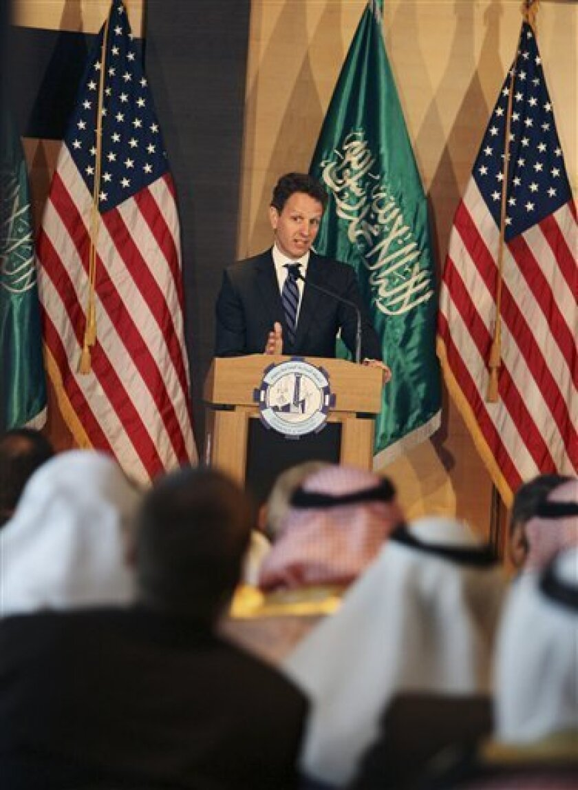 """U.S. Treasury Secretary Timothy Geithner speaks to Saudi business leaders in the commercial hub of Jiddah, Saudi Arabia, Tuesday, July 14, 2009. Geithner said Tuesday, as he kicked off his first official visit to the Middle East, that his country had a """"special responsibility"""" to help guide the world through its worst recession in decades, and stressed that while a recovery was ongoing, setbacks were likely. (AP Photo)"""