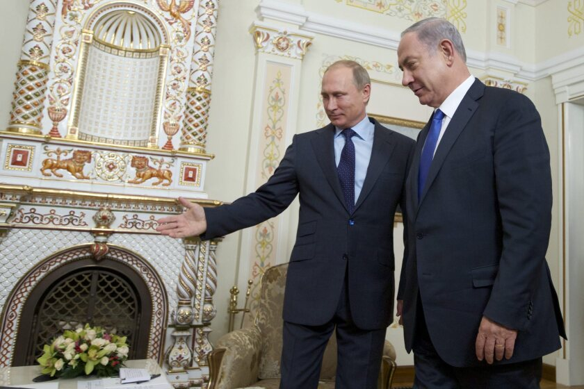Russian President Vladimir Putin, left, met with Israeli Prime Minister Benjamin Netanyahu at a presidential residence near Moscow on Sept. 21 to assure him Russian support for Syria's government won't enhance Hezbollah's ability to strike Israel in the Golan Heights.