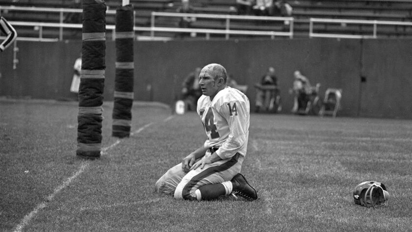 FILE - In this Sept. 20, 1964, file photo, New York Giants' Y.A. Tittle squats on the field after be