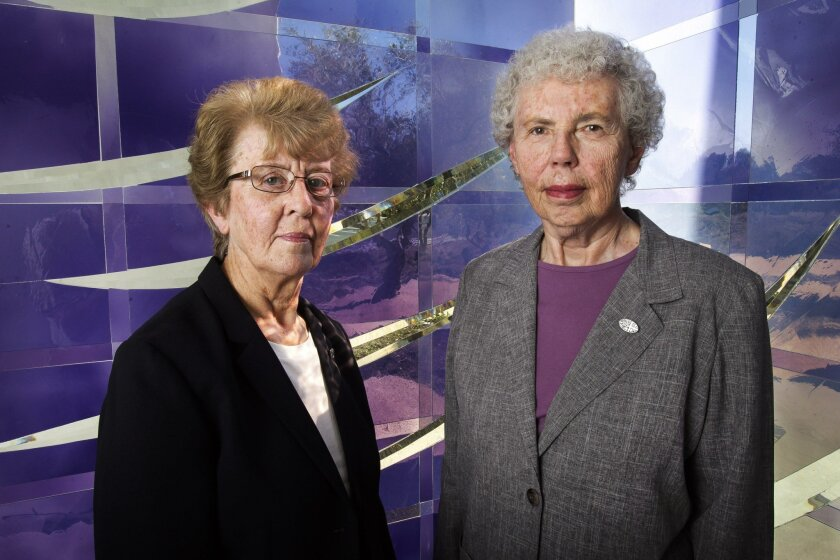 Sister Sheila Novak, left, and Sister Jean Schafer, who started and run a recovery home in North County for victims of human trafficking, posed for a photo at Saint Thomas More Catholic Church in Oceanside on Friday.