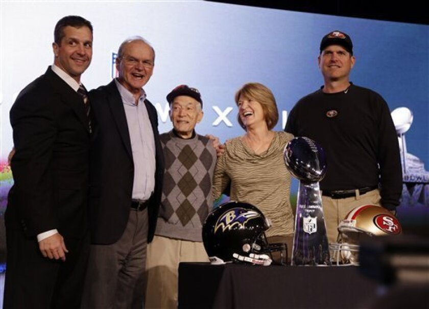 RETRACTS PREVIOUS CORRECTION: THE GRANDFATHER'S NAME IS SPELLED CIPITI, NOT SEPIDI - San Francisco 49ers head coach Jim Harbaugh, right, and Baltimore Ravens head coach John Harbaugh, left, pose with their parents, Jack and Jackie, and grandfather Joe Cipiti during a news conference for the NFL Sup