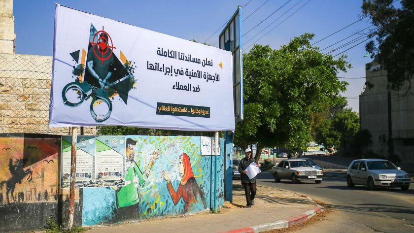 """A banner in Gaza City on Wednesday reads: """"We declare our full support for the security authorities in their measures against collaborators"""" and """"they betrayed and backstabbed and deserved the punishment."""""""