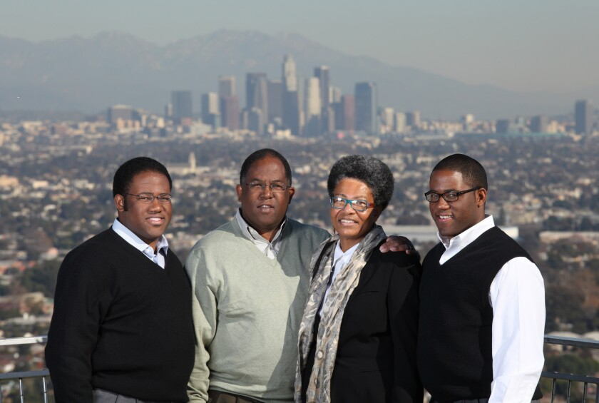 Sebastian Ridley-Thomas, left, is shown in a 2011 photo with his father, Los Angeles County Supervisor Mark Ridley-Thomas, mother Avis and twin brother Sinclair.