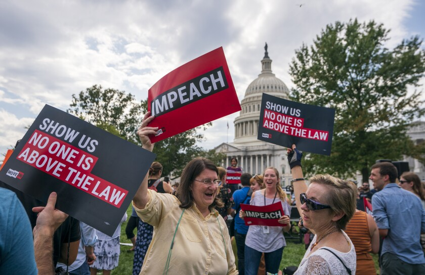 Activists on Thursday rally at the Capitol building in Washington for the impeachment of President Trump.
