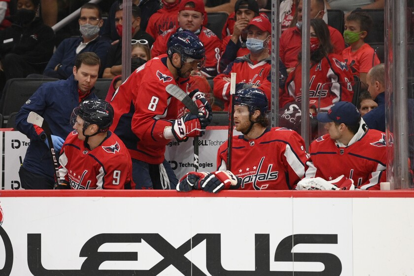 Washington Capitals left wing Alex Ovechkin (8) walks toward the locker room after he was injured during the first period of the team's NHL preseason hockey game against the Philadelphia Flyers, Friday, Oct. 8, 2021, in Washington. (AP Photo/Nick Wass)