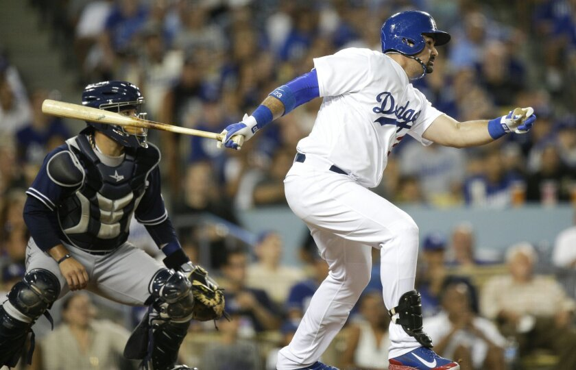 Adrian Gonzalez singles home the tying run in the seventh inning off Andrew Cashner.