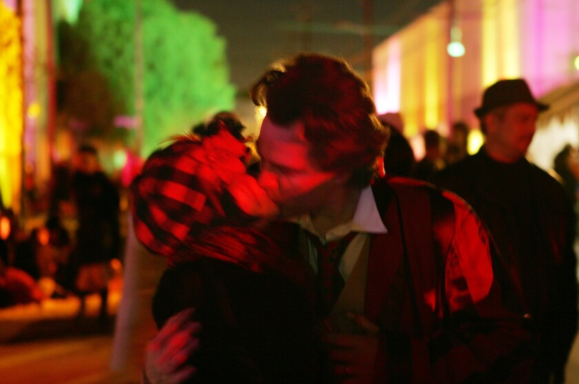 A couple shares a spontaneous moment of love in the street during the Lucent L' Amour street festival held the night of Valentine's Day in downtown Los Angeles on Feb. 15, 2009.