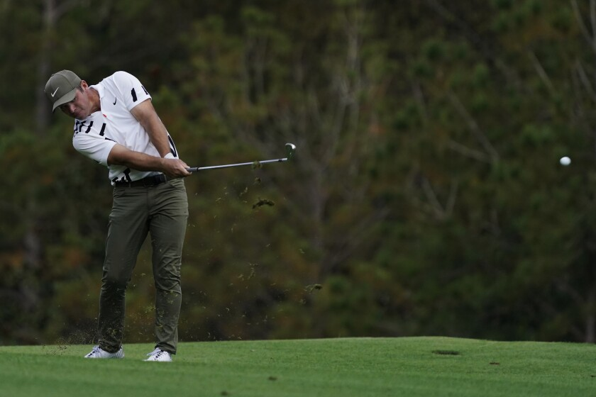 Paul Casey hits on the fifth fairway during the first round of the Masters golf tournament.
