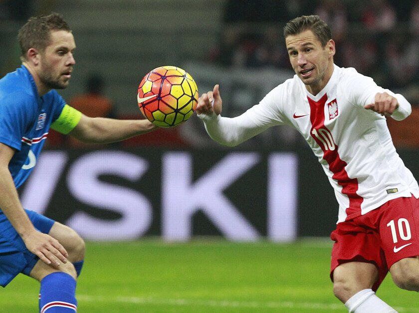 FILE - In this Friday, Nov. 13, 2015. file photo, Poland's Grzegorz Krychowiak, right, fights for the ball with Iceland's Gylgi Thor Sigurdsson during friendly soccer match between Poland and Iceland in Warsaw, Poland. (AP Photo/Czarek Sokolowski, File)