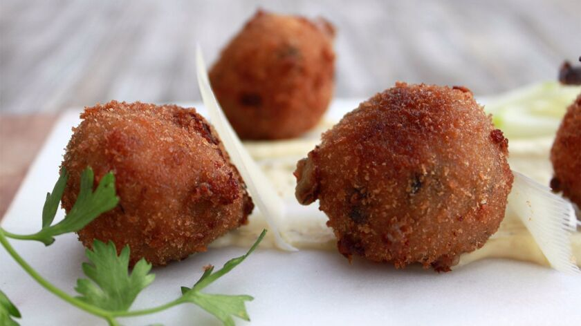 One of the tastiest appetizers at Crudo by Pascal Lorange is the prosciutto and mushroom croquetas, with creamy roasted green apple-garlic aioli.