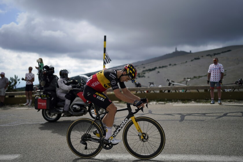 Belgium's Wout Van Aert rides during the ascent of the Mont Ventoux as part of the eleventh stage of the Tour de France cycling race over 198.9 kilometers (123.6 miles) with start in Sorgues and finish in Malaucene, France, Wednesday, July 7, 2021. (AP Photo/Daniel Cole)