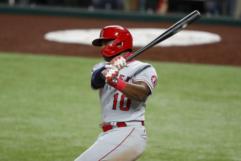 Angels' Justin Upton follows through on a swing against the Texas Rangers.
