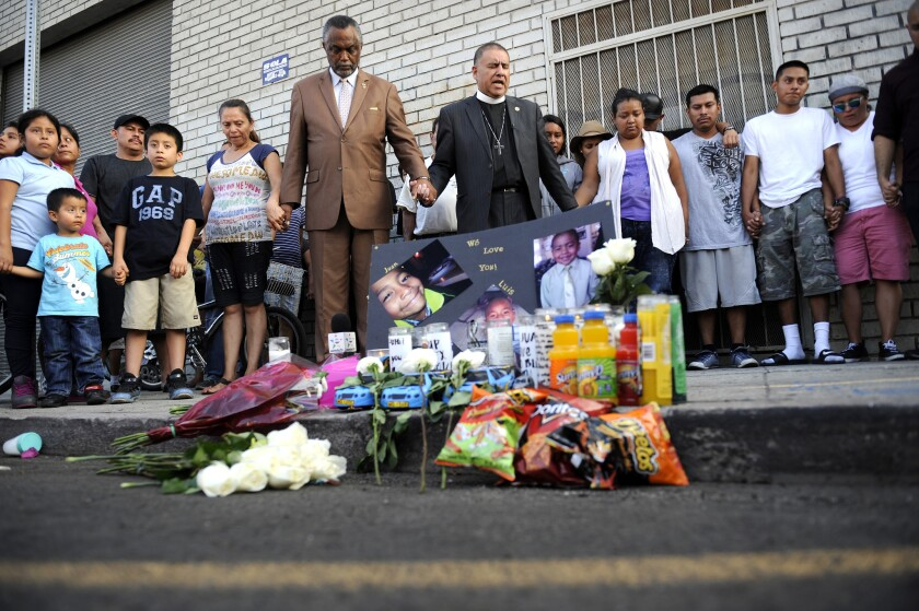 People gathered at the crime scene Wednesday night and placed flowers, candles and food including Cheez-Its and Doritos — the children's favorite snacks — on the sidewalk.
