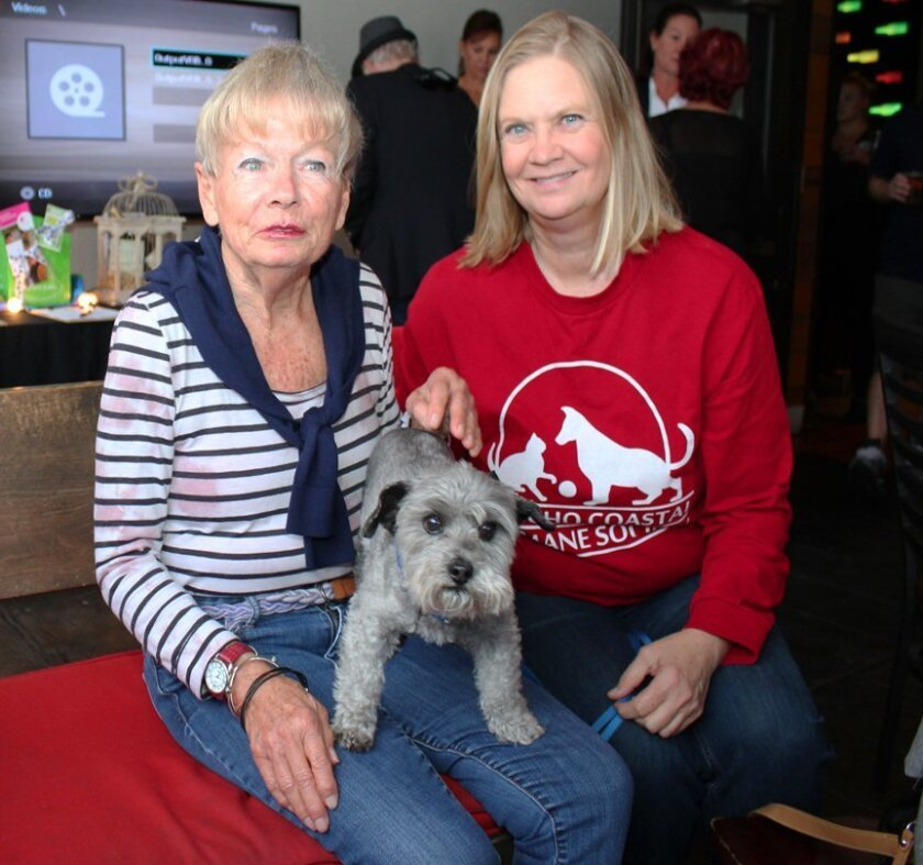 Sue Wilson and Jan Savage with Sir Ruffles von Vicious attend the Paws & Pints fundraiser May 28, 2015 at La Jolla Brewing Co.