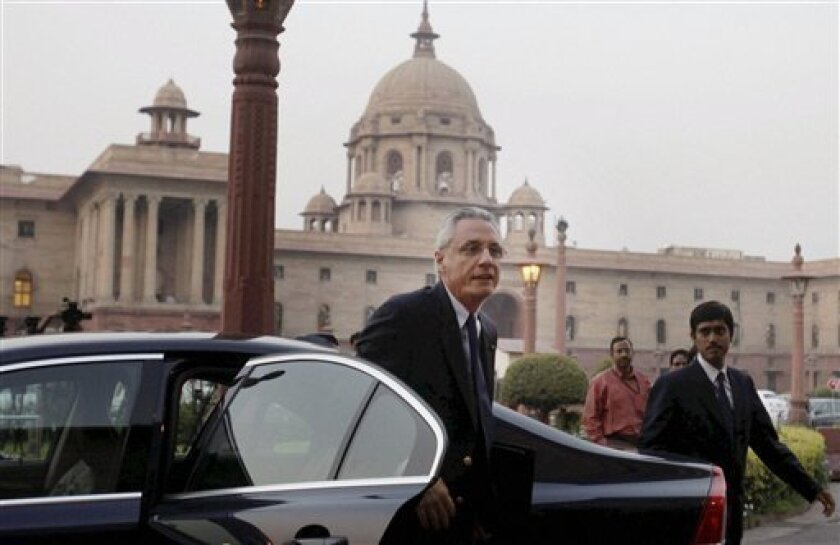 In this Tuesday, March 12, 2013, photograph, Italian Ambassador to India Daniele Mancini, left, arrives at Ministry of External Affairs in New Delhi, India. India said Tuesday that an Italian decision not to return two marines accused of killing a pair of Indian fishermen last year was unacceptable. The government allowed the marines to return to Italy in February to vote in national elections and to celebrate Easter with their families. Italy announced Monday it would not send the marines back