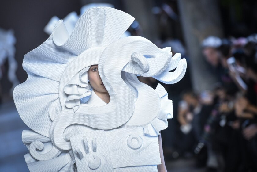 A model wears a creation during Viktor and Rolf's Spring-Summer 2016 Haute Couture fashion collection, presented in Paris, France, Wednesday, Jan. 27, 2016. (AP Photo/Zacharie Scheurer)