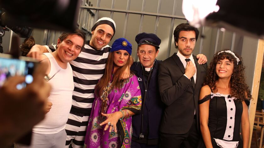 "Emmanuel Plascencia, left, Beto Ruiz, Sonia Monroy, Caesar James, Jeronimo Henao and Patricia Ponce De Leon, the cast of Super Deluxe's live telenovela, during a June production of ""El Hogar Es Donde Esta La Casa."""