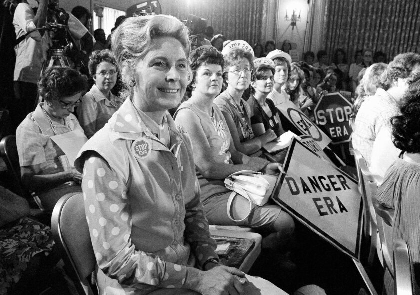 ADVANCE FOR USE MONDAY, JUNE 20, 2016 AND THEREAFTER -FILE - In this Aug. 10, 1976 file photo, women opposed to the Equal Rights Amendment sit with Phyllis Schlafly, foreground, national chairman of Stop ERA, at hearing of Republican platform subcommittee on human rights in Kansas City, Mo. One of