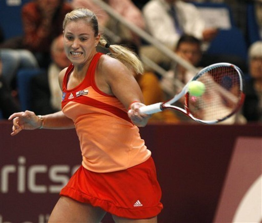 Angelique Kerber of Germany returns the ball to Yanina Wickmayer of Belgium during their semifinal singles match at the GDF Suez WTA Open 2012 tennis tournament at Coubertin stadium in Paris, Saturday, Feb. 11, 2012. (AP Photo/Michel Euler)