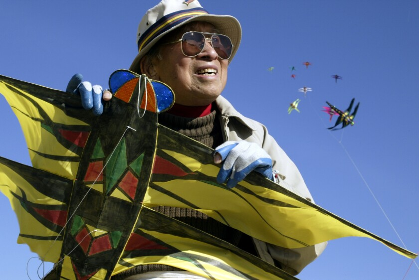 Artist Tyrus Wong, shown on Santa Monica Beach, at age 93 was designing and building kites, some more than 100 feet long.