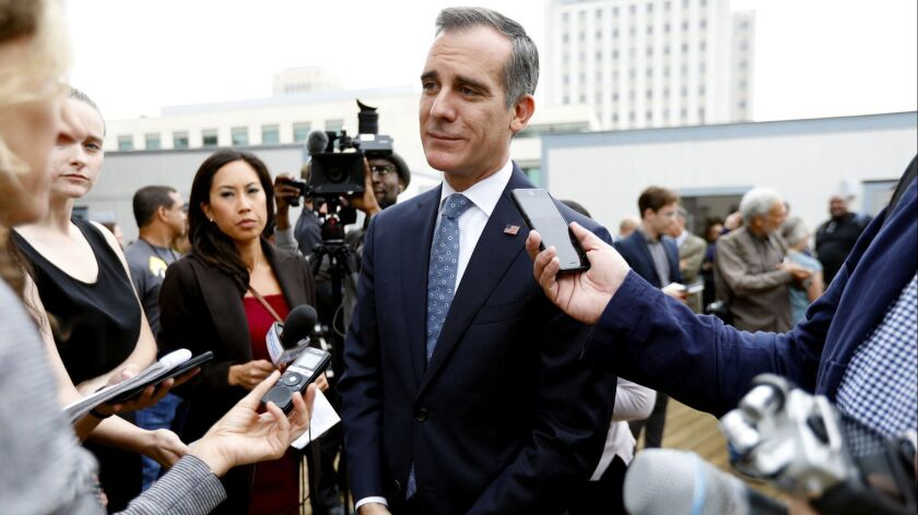 Los Angeles Mayor Eric Garcetti takes questions following a press conference at a temporary shelter trailer in El Pueblo at the corner of Arcadia and Alameda streets in Los Angeles on September 5.