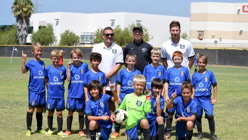 Top row, l-r: Coaches Steve, Gary & Rob; middle row James, Henry, Lucas P., Gavin, Desmond, Elan, Bryce, Elias; front row, Evan, Lucas K., Marcel and Brody.