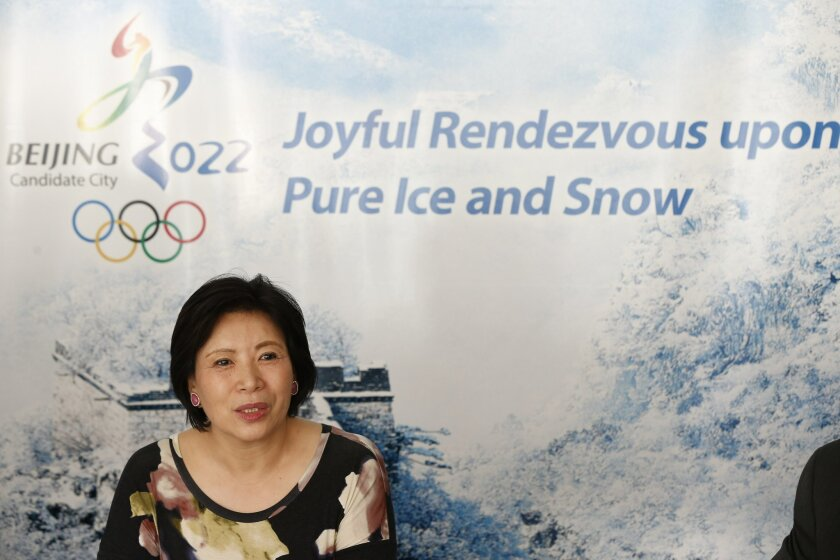 Wang Hui, Spokeswomen of Beijing bid committee, answers a question during a press conference at a hotel in Kuala Lumpur, Malaysia, Monday, July, 27, 2015. Malaysia is hosting the 128th International Olympic Committee executive board meeting where the vote for the host cities of the 2022 Olympic Winter Games and for the 2020 Youth Olympic Winter Games will take place. (AP Photo/Vincent Thian)