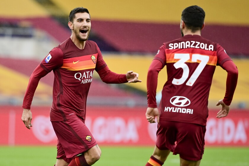 Roma's Lorenzo Pellegrini, left, celebrates with his teammate Leonardo Spinazzola after scoring his side's first goal during a Serie A soccer match between Roma and Inter Milan, at Rome's Olympic Stadium, Sunday, Jan. 10, 2021. (Luciano Rossi/LaPresse via AP)