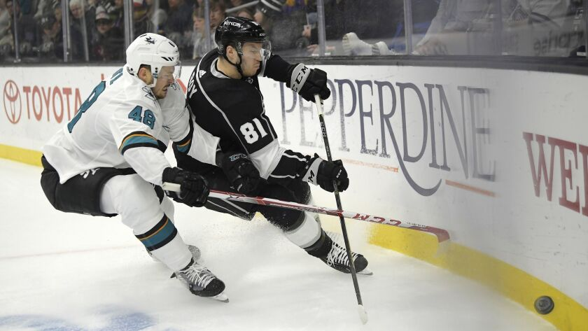 San Jose Sharks center Tomas Hertl, left, and Kings defenseman Matt Roy race to the puck during the first period of the Kings' 4-2 win Thursday.