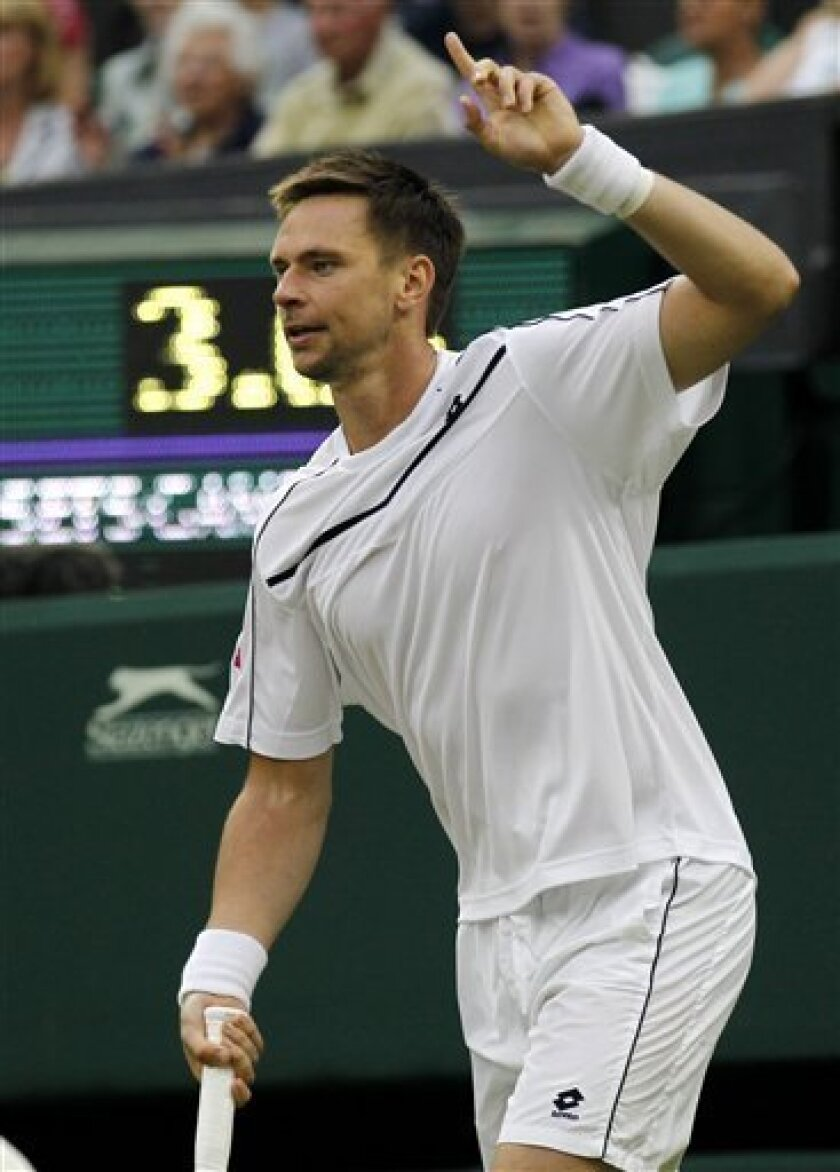 Sweden's Robin Soderling gestures during the match against Australia's Lleyton Hewittat the All England Lawn Tennis Championships at Wimbledon, Thursday, June 23, 2011. (AP Photo/Anja Niedringhaus)