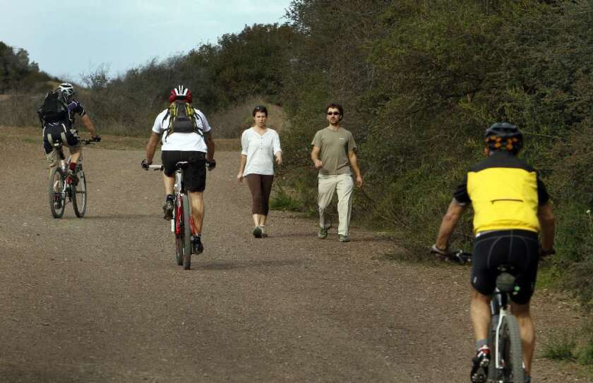 Mandeville Canyon fire road allows a mix of hikers and bikers, but in L.A.'s Griffith Park, bikes are allowed only on the asphalt roads.