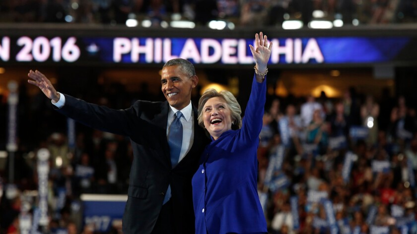 Hillary Clinton, seen with Barack Obama at the Democratic convention, has praised the president's record on the economy.