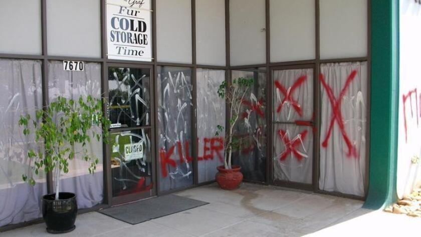 Vandalism by animal-rights activists is shown at the Furs by Graf store in Kearny Mesa in 2013.