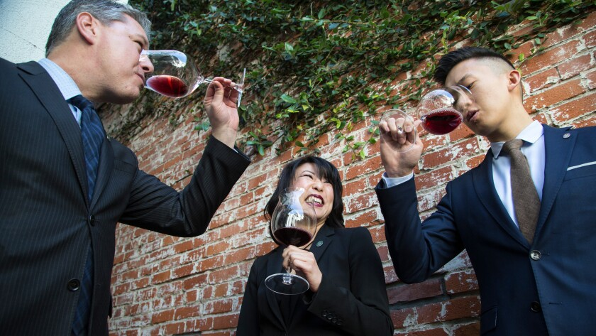 Spago wine director Phillip Dunn, left, assistant wine director Rina Bussell and cellarmaster Eric Denq taste a 2010 Gevrey-Chambertin French Burgundy.