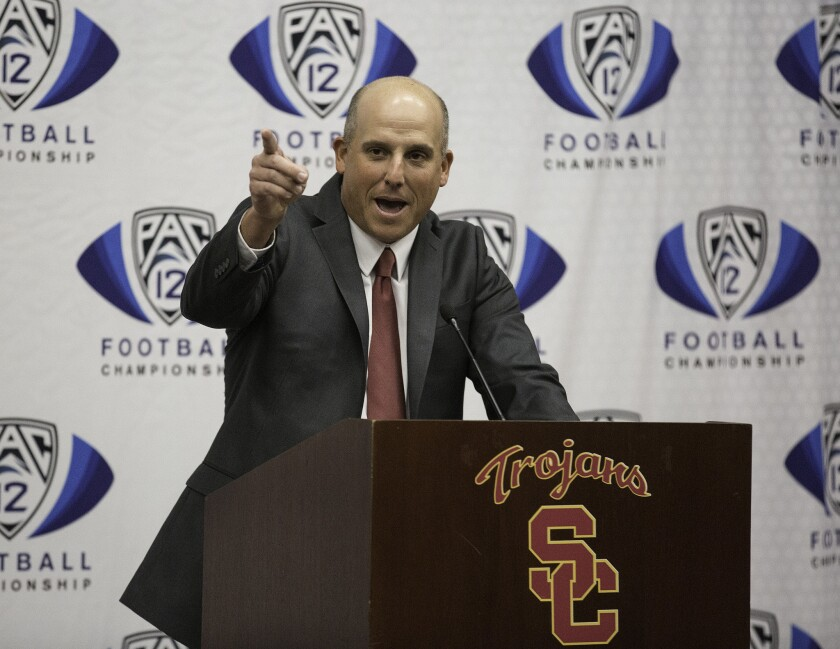 Clay Helton speaks Monday after being introduced as the Trojans' permanent head football coach during a news conference at USC.