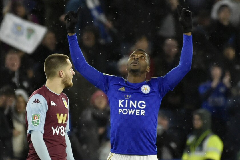 Leicester's Kelechi Iheanacho, center, celebrates after scoring his side's opening goal during the English League Cup semifinal first leg soccer match between Leicester City and Aston Villa at the King Power Stadium in Leicester, England, Wednesday, Jan. 8, 2020. (AP Photo/Rui Vieira)
