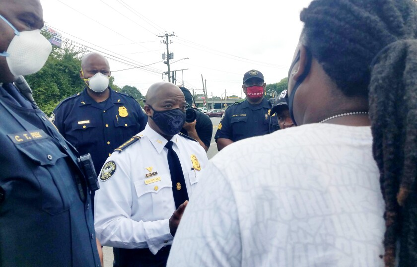 Lady A, an organizer of the Rayshard Brooks Peace Camp, speaks to the Atlanta Police Department's interim police chief