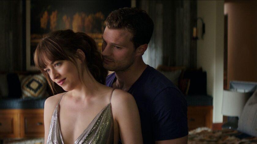 "Dakota Johnson and Jamie Dornan as Anastasia Steele and Christian Grey in ""Fifty Shades Freed."""