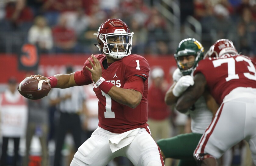 Oklahoma quaterback Jalen Hurts looks to pass the ball against Baylor in the first quarter of the Big 12 championship on Dec. 7 in Arlington, Texas.