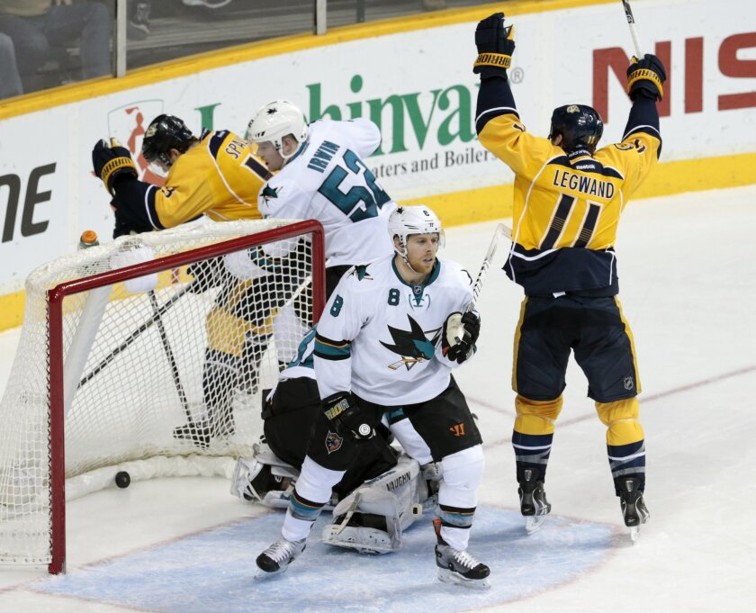 Nashville Predators forward David Legwand (11) celebrates a goal by teammate Mattias Ekholm, not shown, against the San Jose Sharks in the second period of an NHL hockey game Tuesday, Jan. 7, 2014, in Nashville, Tenn. Defending for the Sharks are Joe Pavelski (8) and Matt Irwin (52). (AP Photo/Mark