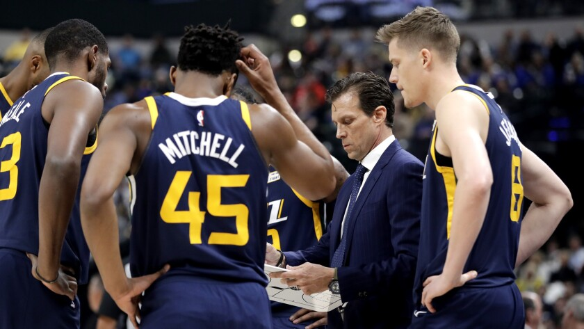 Utah Jazz head coach Quin Snyder talks to his team during the first half of an NBA basketball game a