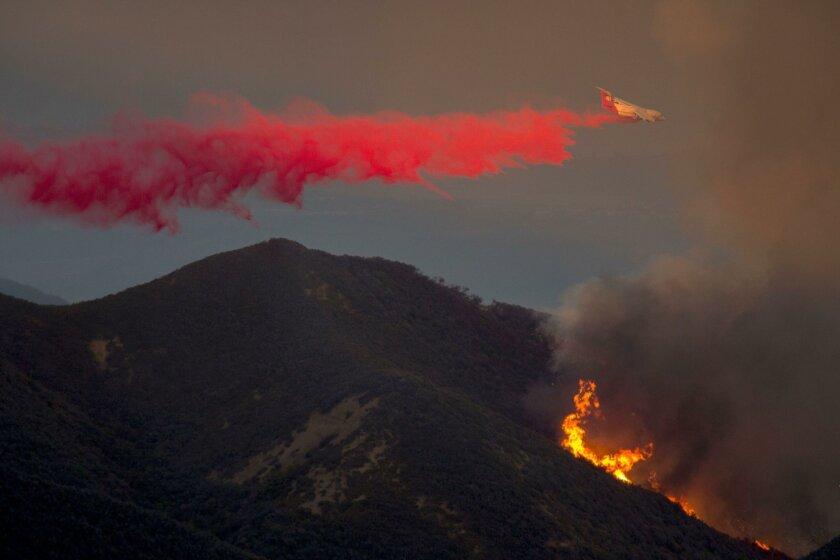 A firefighting jet drops fire retardant last month at the Sherpa Fire near Santa Barbara.