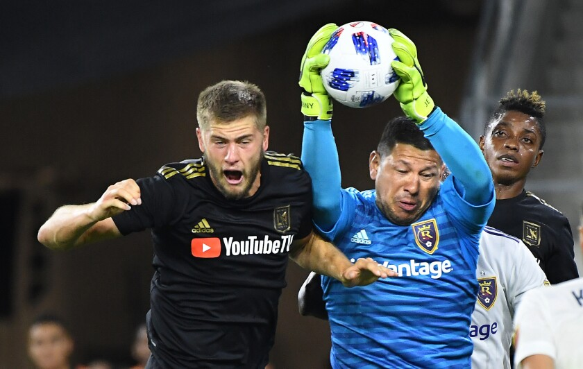 LAFC's Walker Zimmerman tries to head the ball into the net but Real Salt Lake goalie Nick Rimando makes a save in the first half during a playoff game at Banc of California Stadium on Nov. 1, 2018.