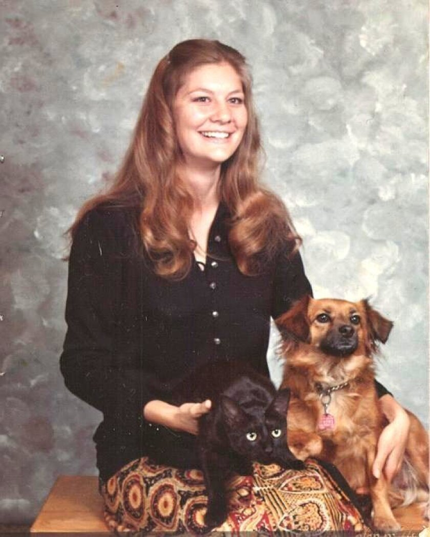 A young Sherri Lightner with her pets, Kitty and Bobbi.