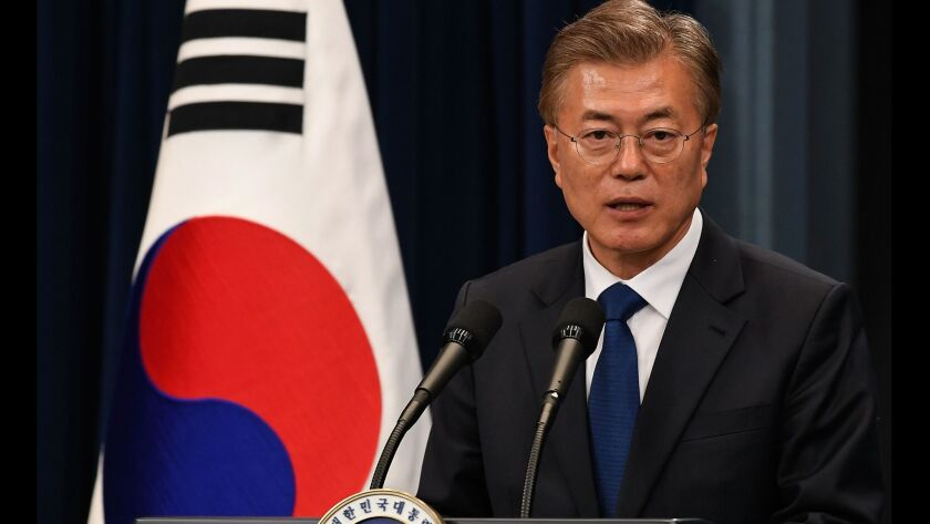 South Korea's new president takes office, signals