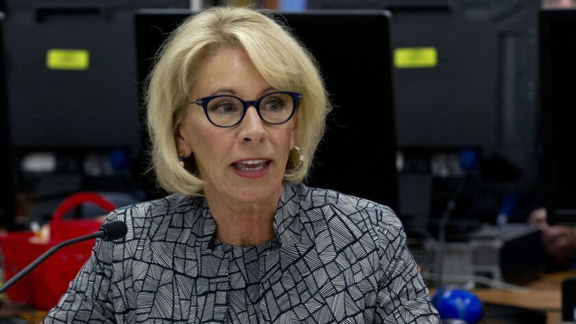 FILE - In this May 31, 2018 file photo, Education Secretary Betsy DeVos speaks during a visit of the